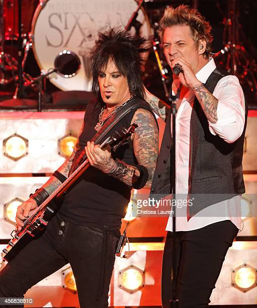 Musician Nikki Sixx and vocalist James Michael of SixxAM perform at iHeartRadio Theater on October 7 2014 in Burbank California