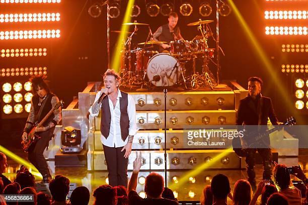 Musician Nikki Sixx vocalist James Michael and musician DJ Ashba of SixxAM perform at iHeartRadio Theater on October 7 2014 in Burbank California