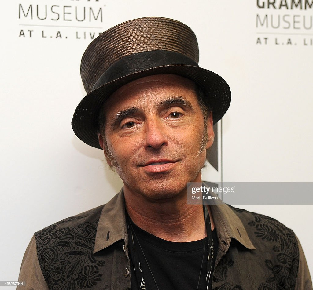 Musician Nils Lofgren poses before An Evening With Nils Lofgren at The GRAMMY Museum on August 5, 2014 in Los Angeles, California.