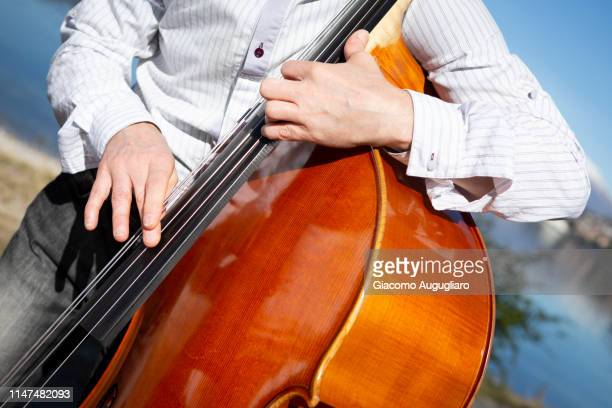 musician of contra bassoon detail, lecco, lombardy, italy - bassoon stock pictures, royalty-free photos & images