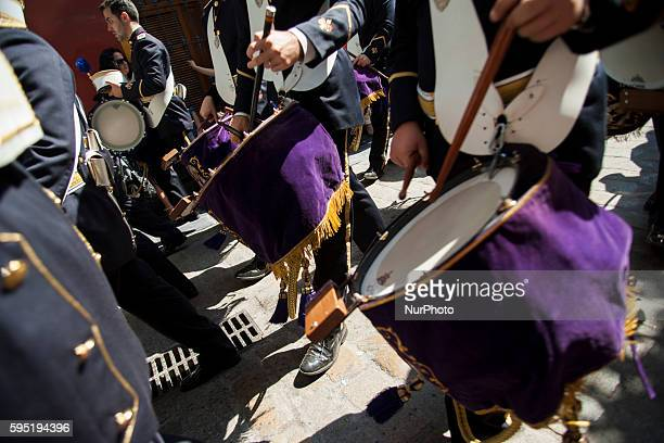 Musician of the Brotherhood called quotLa Pazquot during its parade to Cathedral on Sunday of Palms day called Domingo de Ramos in Spanish Seville...