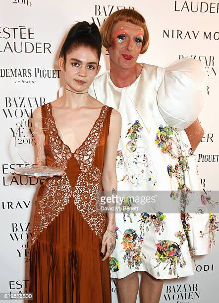 Musician of the Year winner Grimes and presenter Grayson Perry attend the Harper's Bazaar Women of the Year Awards 2016 at Claridge's Hotel on...