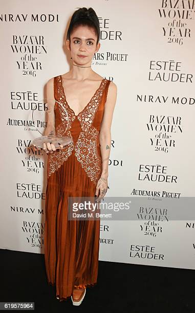 Musician of the Year winner Grimes attends the Harper's Bazaar Women of the Year Awards 2016 at Claridge's Hotel on October 31 2016 in London England