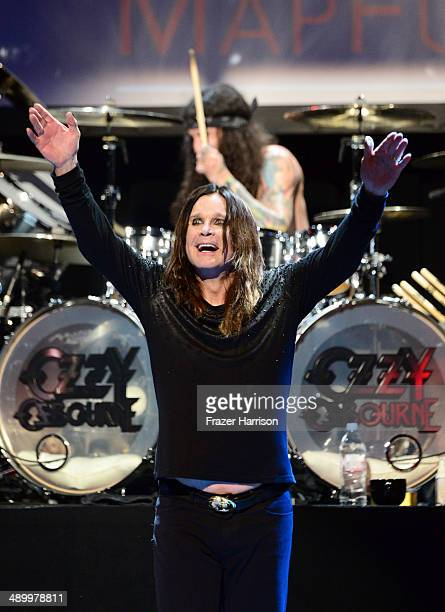 Musician Ozzy Osbourne performs onstage at the 10th annual MusiCares MAP Fund Benefit Concert at Club Nokia on May 12, 2014 in Los Angeles,...