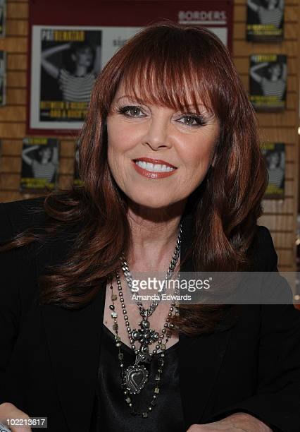 Musician Pat Benatar poses before signing copies of her book 'Between A Heart And A Rock Place' at Borders on June 18 2010 in Westwood California