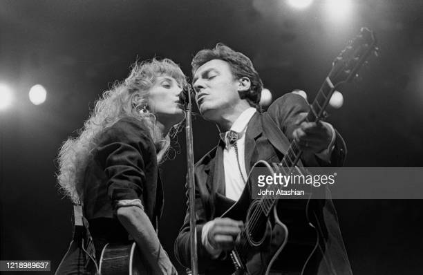 Musician Patti Scialfa and Bruce Springsteen are shown performing on stage during a live concert appearance on February 28 1988