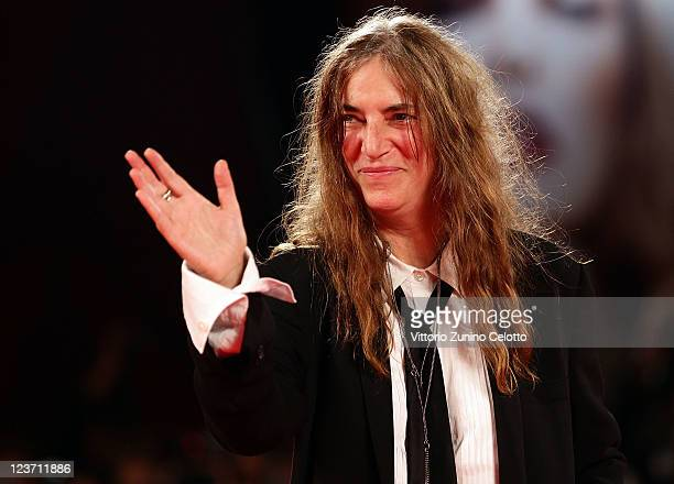 Musician Patti Smith performs at the 'Pivano Blues Sulla Strada Di Nanda' premiere during the 68th Venice Film Festival at Palazzo del Cinema on...