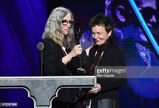Musician Patti Smith speaks with Laurie Anderson speaking on behalf of inductee Lou Reed during the 30th Annual Rock And Roll Hall Of Fame Induction...