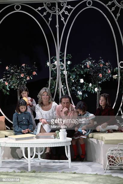 Musician Paul Anka and his wife Anne de Zogheb sit with four of their daughters during a photo shoot circa 1970's