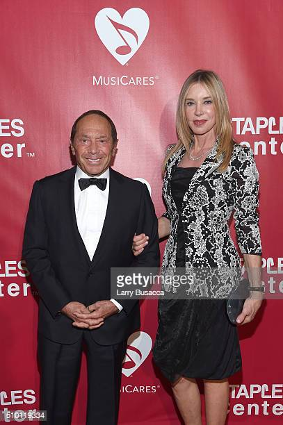 Musician Paul Anka and Lisa Pemberton attend the 2016 MusiCares Person of the Year honoring Lionel Richie at the Los Angeles Convention Center on...