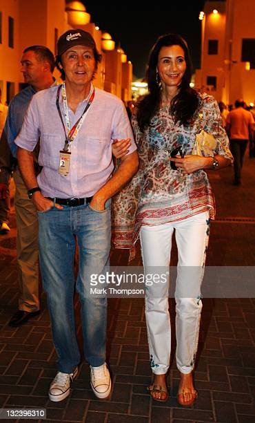 Musician Paul McCartney and his wife Nancy Shevell walk in the paddock following qualifying for the Abu Dhabi Formula One Grand Prix at the Yas...