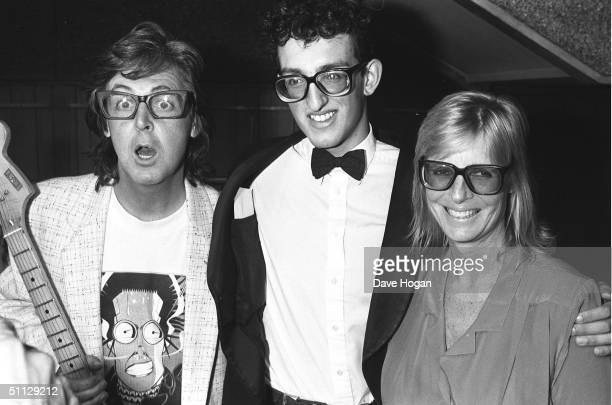 Musician Paul McCartney and wife Linda pose with a Buddy Holly Look-a-like at a Buddy Holly tribute dinner in London.