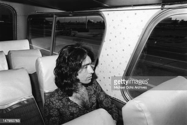 Musician Paul Rodgers of the rock and roll band 'Bad Company' sits on a bus in circa 1976
