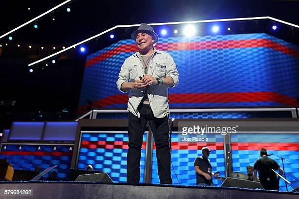 Musician Paul Simon stands on stage during the setup of the Democratic National Convention at the Wells Fargo Center July 24 2016 in Philadelphia...