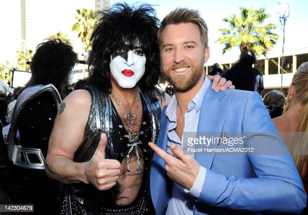 Musician Paul Stanley of the band KISS and singer Charles Kelley of Lady Antebellum arrive at the 47th Annual Academy Of Country Music Awards held at...