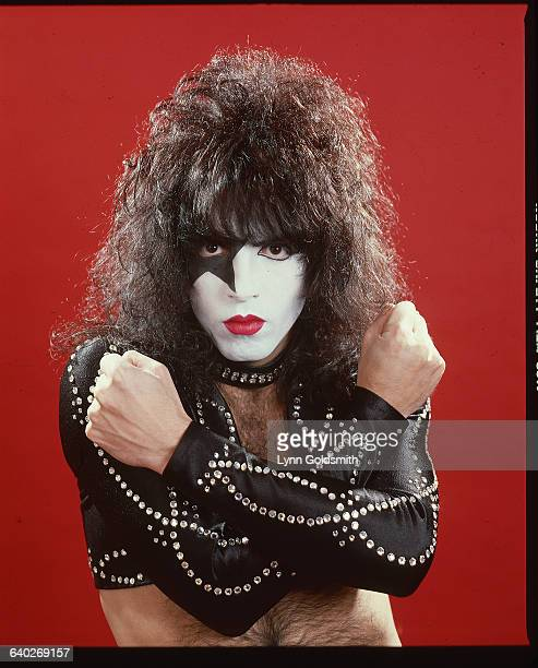 Musician Paul Stanley of the glamrock band Kiss poses in his stage costume He is wearing face paint a studded dog collar and studded leather sleeves...