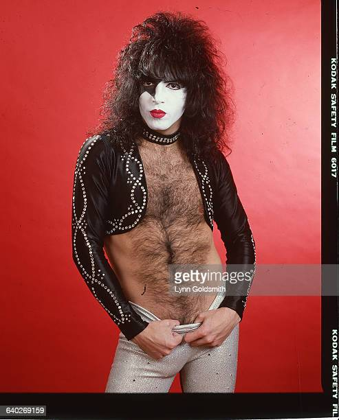 Musician Paul Stanley of the glamrock band Kiss poses in his stage clothing He is wearing face paint a studded dog collar rhinestone studded cropped...