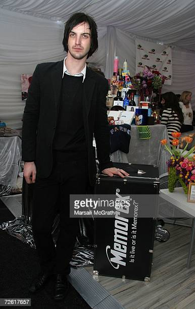 Musician Paul Wilson of the group Snow Patrol poses with the distinctive assets gift bag backstage at the American Music Awards with distinctive...