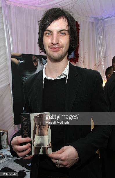 Musician Paul Wilson of the group Snow Patrol poses with the DKNY display backstage at the American Music Awards with distinctive assets held at the...