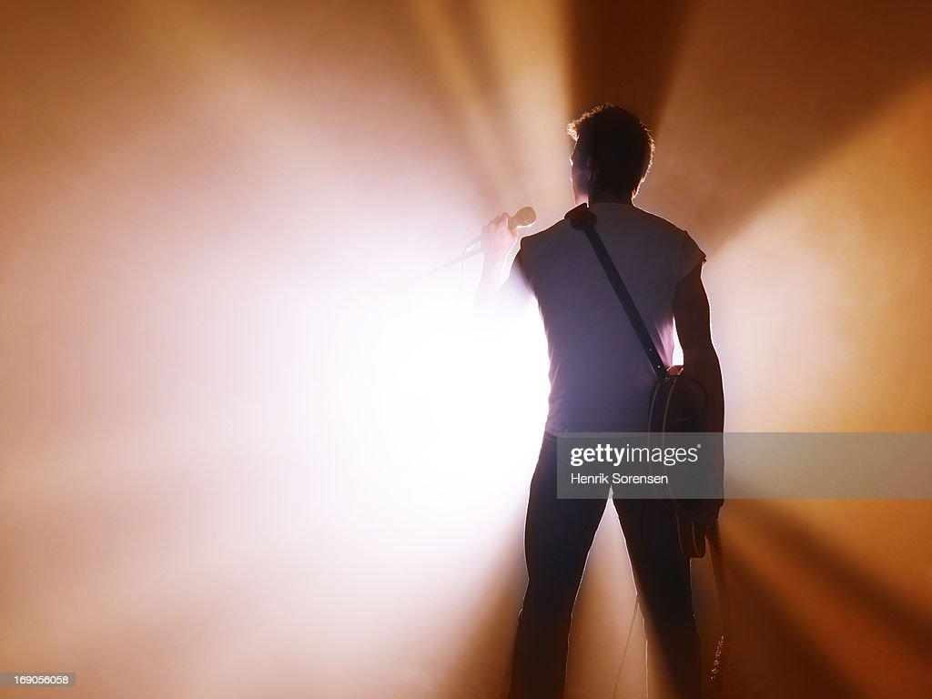 Musician performing on stage : Stock Photo