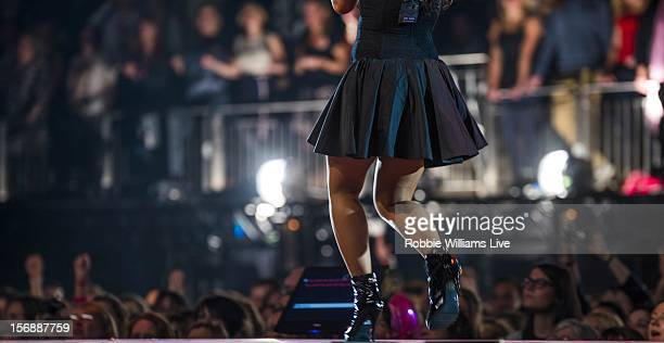 A musician performs during the second night of the Robbie Williams tour at 02 Arena on November 23 2012 in London England