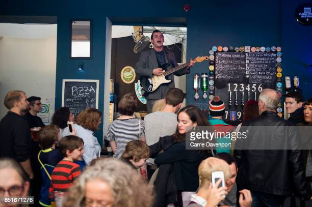 A musician performs on the bar of the Black Box at Culture Night Belfast on September 22 2017 in Belfast Northern Ireland