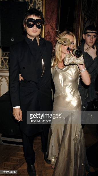 Musician Pete Doherty and model Kate Moss wearing Philip Treacy masks attend the Moet Chandon Fashion Tribute recognising those who have influenced...