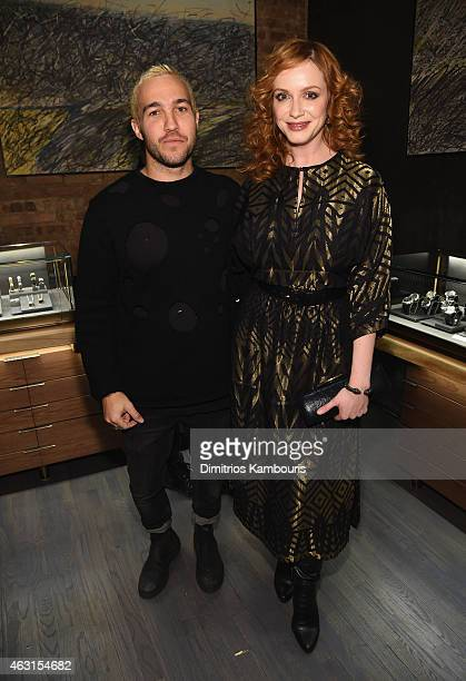 Musician Pete Wentz poses for a photo with actress Christina Hendricks at the David Yurman Soho Boutique Grand Opening event to benefit New Yorkers...