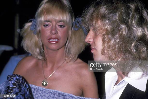 Musician Peter Frampton and girlfriend Penny McCall attend The City of Hope's Spirit of Life Award Dinner Salute to Clive Davis on February 24 1978...