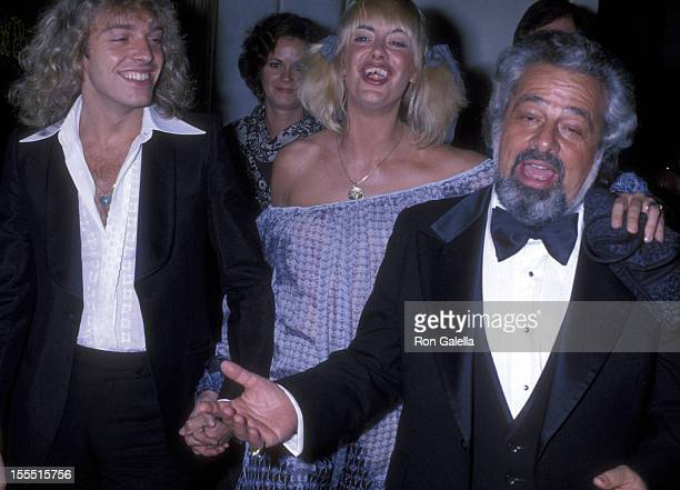 Musician Peter Frampton Penny McCall and manager Dee Anthony attend the party honoring Clive Davis on February 24 1978 at the Beverly Wilshire Hotel...