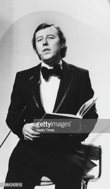 Musician Peter Skellern pictured performing while holding a large book, November 30th 1980.