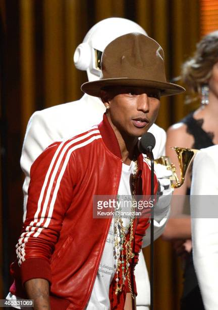 Musician Pharrell Williams accepts the Record of the Year award for 'Get Lucky' onstage during the 56th GRAMMY Awards at Staples Center on January 26...