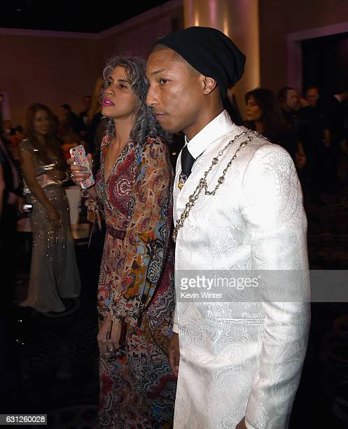 Musician Pharrell Williams and executive producer Mimi Valdes attend the 74th Annual Golden Globe Awards at The Beverly Hilton Hotel on January 8...
