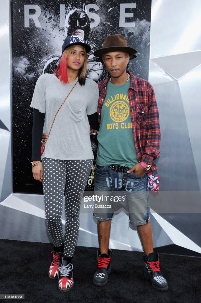 Musician Pharrell Williams (R) and guest attend 'The Dark Knight Rises' premiere at AMC Lincoln Square Theater on July 16, 2012 in New York City.