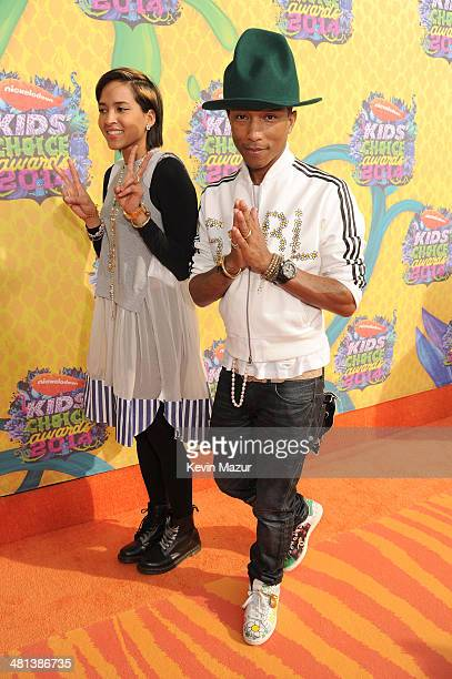 Musician Pharrell Williams and Helen Lasichanh attend Nickelodeon's 27th Annual Kids' Choice Awards held at USC Galen Center on March 29 2014 in Los...