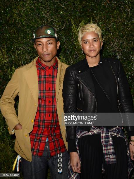 """Musician Pharrell Williams and Helen Lasichanh attend the CHANEL Dinner For NRDC """"A Celebration Of Art, Nature And Technology"""" held at a private..."""