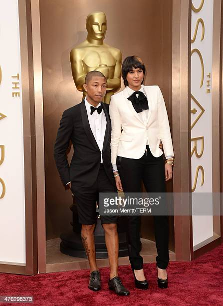 Musician Pharrell Williams and Helen Lasichanh attend the Oscars held at Hollywood Highland Center on March 2 2014 in Hollywood California
