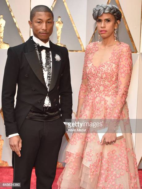 Musician Pharrell Williams and Mimi Valdes attend the 89th Annual Academy Awards at Hollywood Highland Center on February 26 2017 in Hollywood...