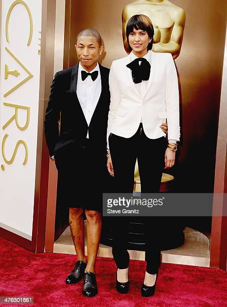 Musician Pharrell Williams and wife Helen Lasichanh attend the Oscars held at Hollywood Highland Center on March 2 2014 in Hollywood California