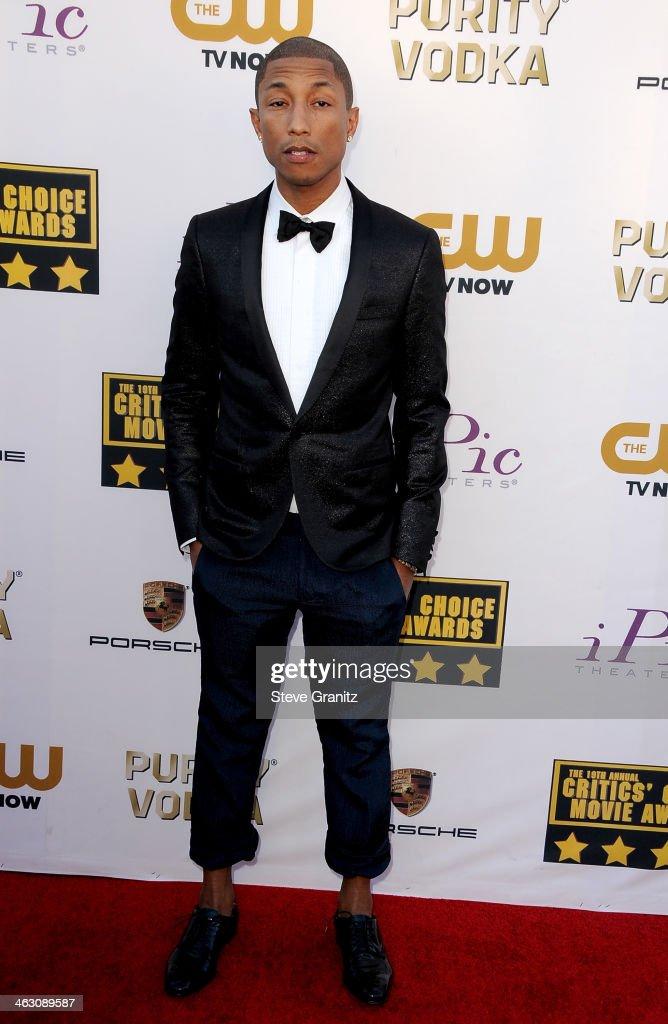 Musician Pharrell Williams attends the 19th Annual Critics' Choice Movie Awards at Barker Hangar on January 16, 2014 in Santa Monica, California.