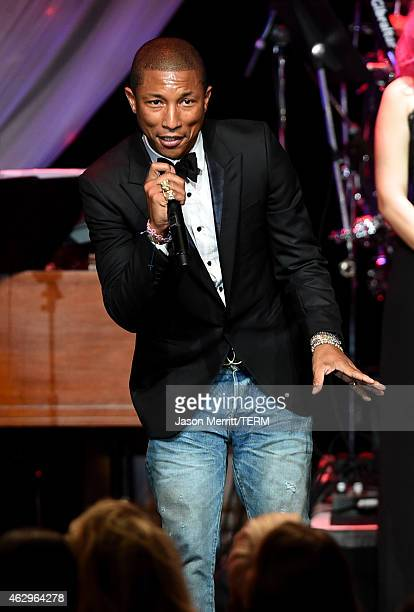 Musician Pharrell Williams performs onstage at the PreGRAMMY Gala and Salute To Industry Icons honoring Martin Bandier at The Beverly Hilton Hotel on...
