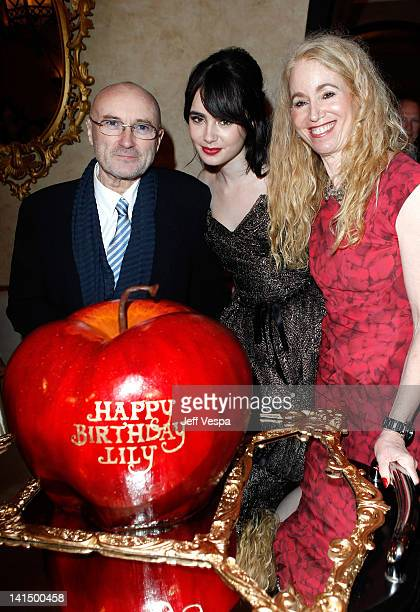 Musician Phil Collins actress Lily Collins and Jill Tavelman attend the after party for the 'Mirror Mirror' premiere at the Roosevelt hotel on March...
