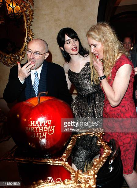 Musician Phil Collins actress Lily Collins and Jill Tavelman attend the after party for the Mirror Mirror premiere at the Roosevelt hotel on March 17...