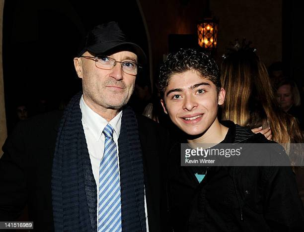 Musician Phil Collins and actor Ryan Ochoa pose at the after party for the premiere of Relativity Media's 'Mirror Mirror' at the Hollywood Roosevelt...