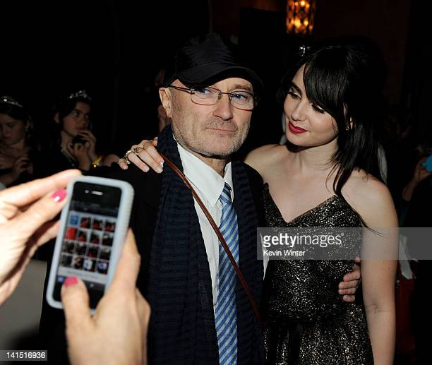 Musician Phil Collins and his daughter actress Lily Collins pose at the after party for the premiere of Relativity Media's 'Mirror Mirror' at the...