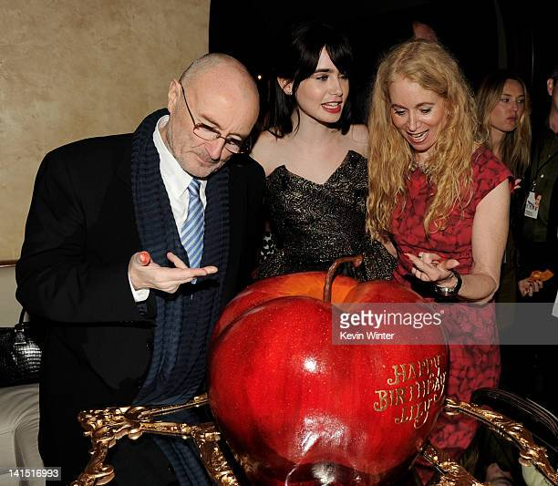 Musician Phil Collins, his daughter actress Lily Collins and her mom Jill Tavelman pose with Lily's birthday cake at the after party for the premiere...
