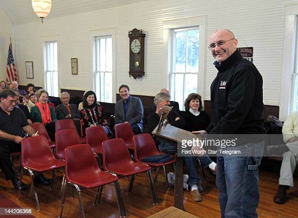 Musician Phil Collins laughs while speaking about his new book and life long fascination with the Alamo in Buffalo Gap Texas May 8 2012