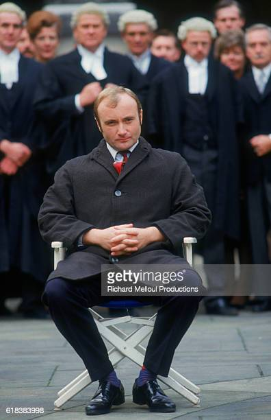 Musician Phil Collins sits on the set of the 1988 British film Buster directed by David Green Collins played the lead character Buster Edwards