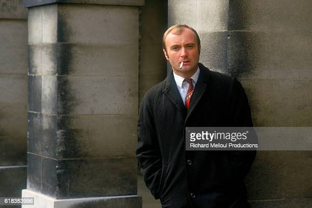 Musician Phil Collins stands on the set of the 1988 British film Buster directed by David Green Collins played the lead character Buster Edwards