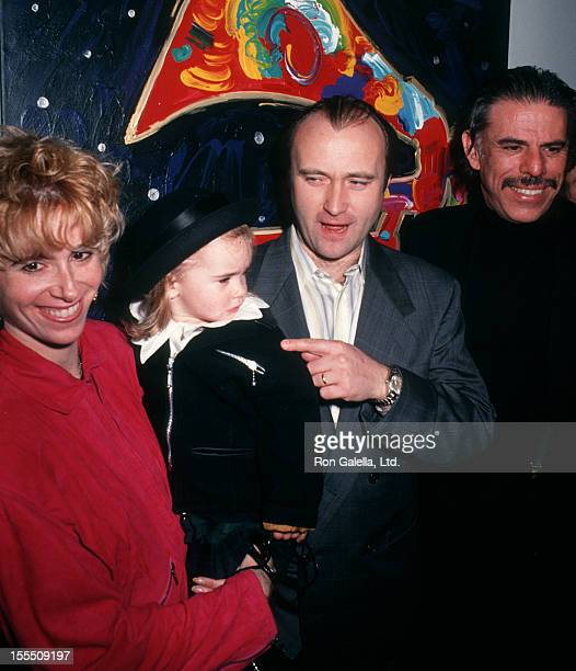 Musician Phil Collins wife Jill Tavelman and daughter Lily Collins and artist Peter max attend the opening of Peter Max Frammy 91 Exhibit on February...